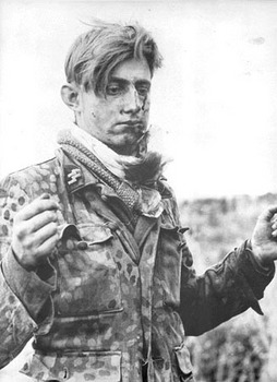 12th_SS_troops_captured-surrender_to_Canadians,_Normandy_1944.jpg