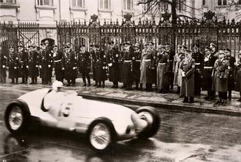 1939, A racing car passing by Hitler.jpg