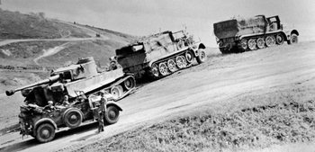 2 Famo Heavy Half-tracks recovering a broken down but servicable Tiger I..jpg