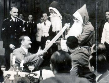 Adolf Hitler getting some presents from Santa Claus.jpg