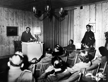 Adolf Hitler making radio broadcast from bunker HQ Wolfschanze, aka the Wolf's Lair, hours after he survived an assassination attempt by members of his own military, 20 July 1944.jpg