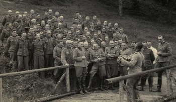 An accordionist leads a sing-along for SS officers at their retreat at Solahutte outside Auschwitz.jpg