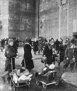 Berlin women and children in front of a huge flak tower.jpg