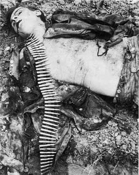 Dead_machine_gunner_from_25_SS_Panzergrenadier_Regiment_of_Hitlerjugend_beside_a_trench_in_Malon,_Normandy_9_7_44.jpg