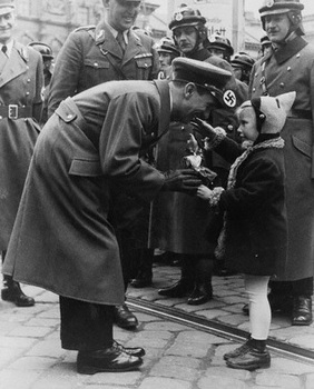 Dr Goebbels is greeted by a young admirer.jpg