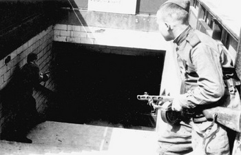 Fighting the last vestiges of German resistance in the Berlin subway.jpg
