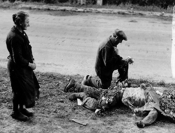 French townspeople lay flowers on the body of an American soldier..jpg