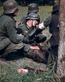 German medic and comrades help a soldier who just had his arm blown off on the East Front.jpg