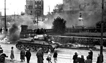 German people watch helplessly as a Red Army tank trundles on a street in Konigsberg in 1945.jpg
