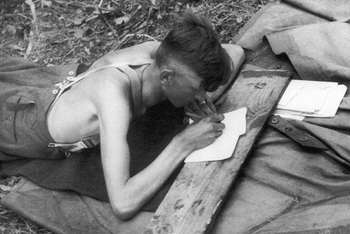 German_soldier_writing_letter_post.jpg