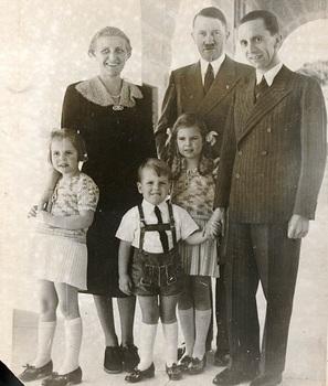 Goebbels and his wife, Magda are pictured with Hitler, centre, and their children.jpg