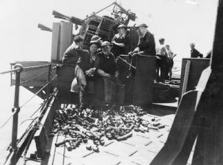 HMS MANCHESTER, enjoy cigarettes during a lull in the action..jpg