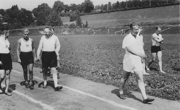 Himmler Walking on track with other SS men.jpg