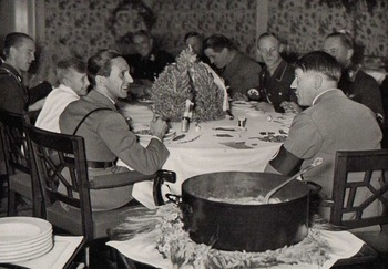 Hitler with officers at dinner. Dr. Joseph Goebbels is seated at his left.jpg
