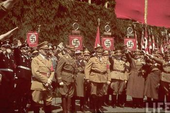 Hitler, Heinrich Himmler, Viktor Lutze, Adolf Hühnlein and other Nazi leaders attend a cornerstone ceremony at the Fallersleben Volkswagen Works on 25th June 1938.jpg