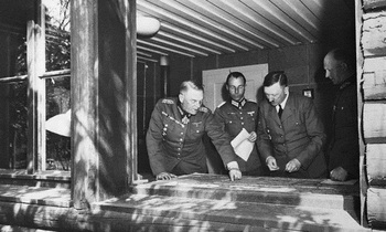 Keitel, (right). Looking on are Major Deile, (holding paper), and General Jodl.jpg
