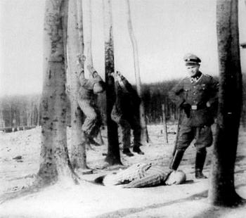Kurt Franz administers punishment in Buchenwald.jpg