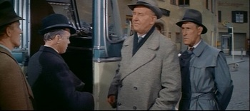 MacDonald, having earlier in the film warned a fellow prisoner about inadvertently responding in English, is here caught out by a Gestapo agent using the same trick.jpg