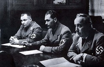 Martin Bormann, Rudolf Hess, and Robert Ley at a meeting in 1935.jpg