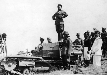 Mussolini giving an address from the top of an armoured vehicle, circa 1940.jpg