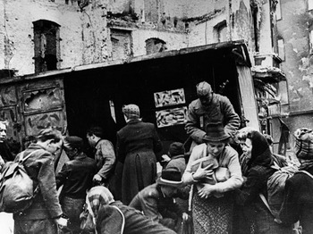 Red Army soldiers distributing bread to Berlin residents after Germany surrender in 1945.jpg