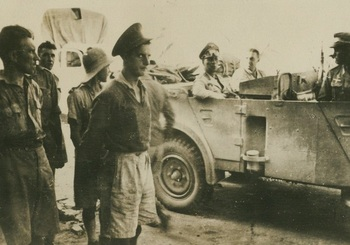 Rommel_in_the_back_of_a_Horch,_being_driven_by_British_POW_Officers.jpeg
