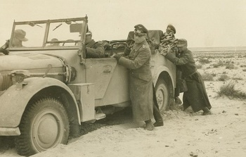 Rommel_pushes_his_His_staff_car_who_was_stuck_in_the_sand.jpeg