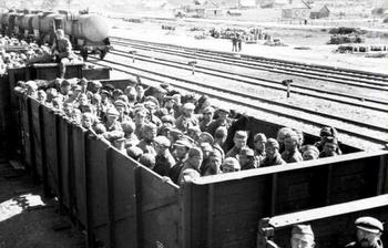Soviets Transport German POWs to Gulags In Massive Boxcars.jpg