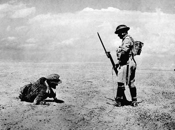 The guard protects the wounded German officer, found in the desert in Egypt in the early days of the British attack.jpg