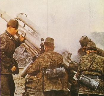Waffen SS Handshar Division troops firing an artillery piece.jpg