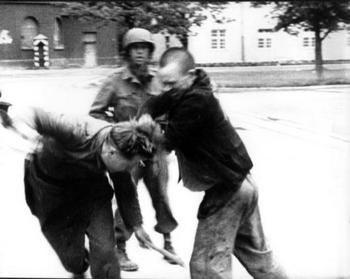 freed prisoner fights a German soldier who was recently captured by the U.S soldiers at the Dachau concentration camp.jpg