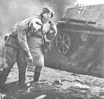 soviet nurse helping a wounded soldier in the battlefield, WWII.jpg